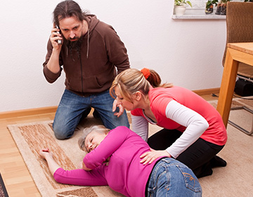 Two people assisting in first aid