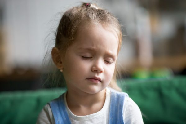 Young girl with eyes closed